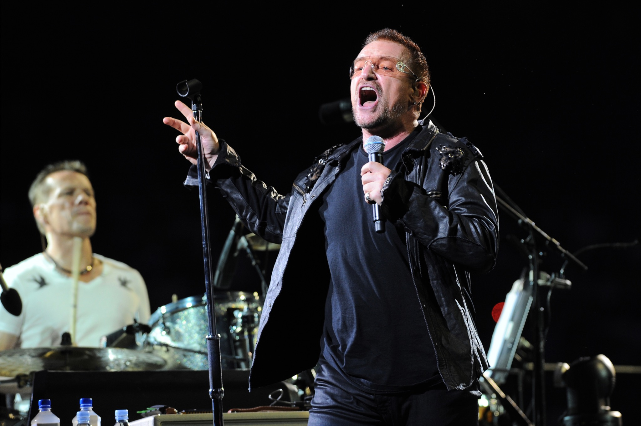 Bono singing in a concert
