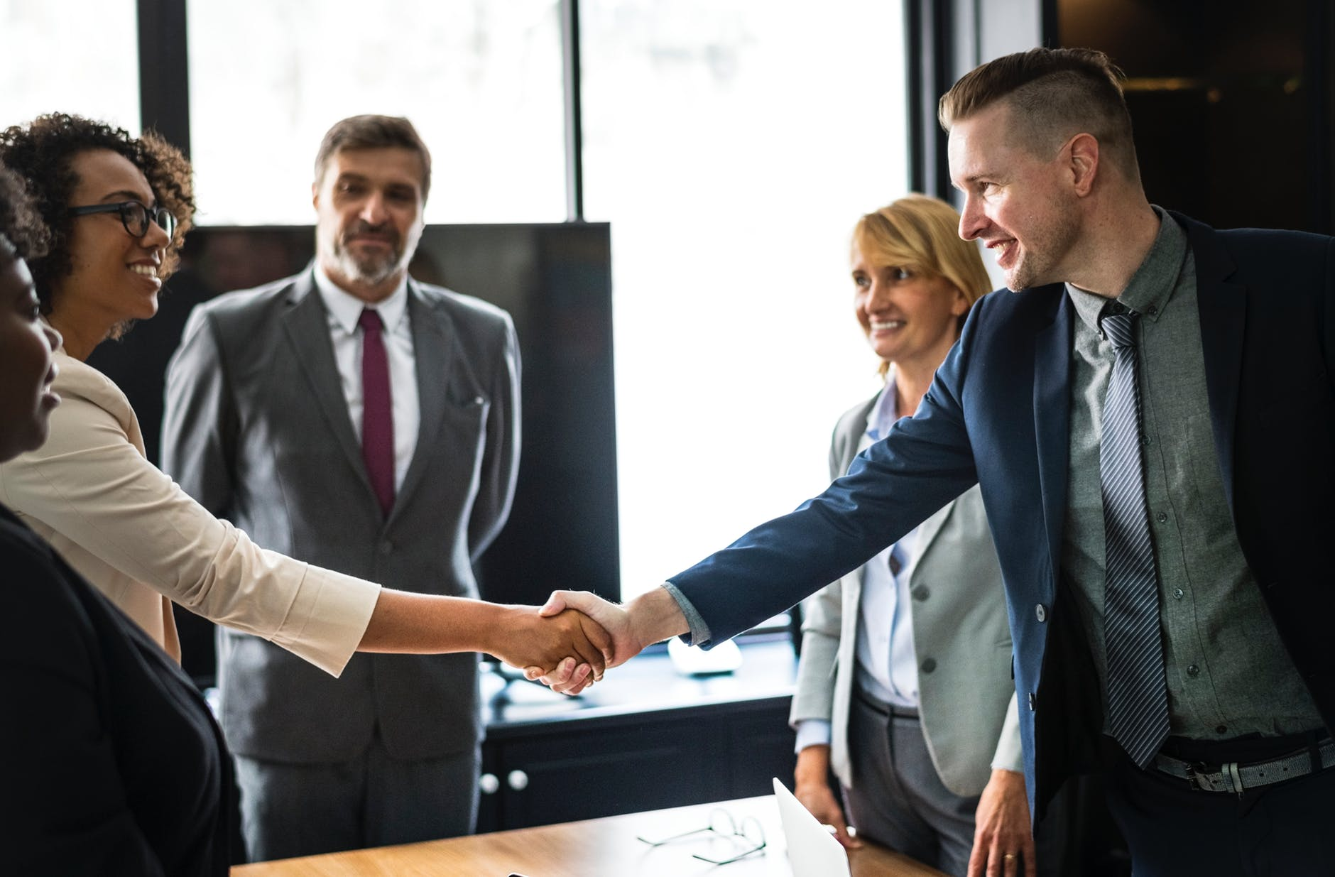 Business team members shaking hands