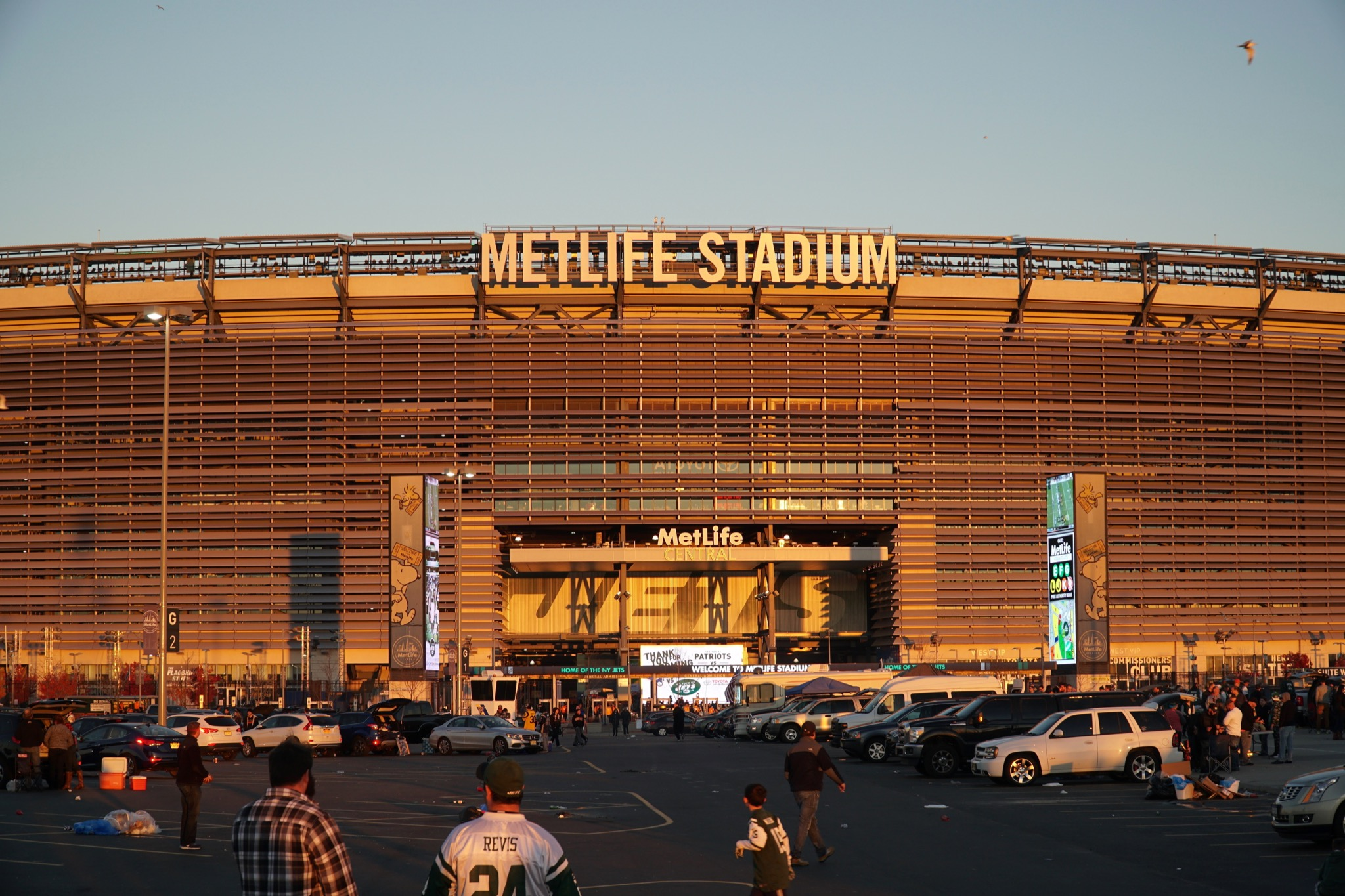 East Rutherford, New Jersey - November 2016: Metlife Stadium at sunset golden hour before New York Jets football game as fans tailgate before enter arena - Image