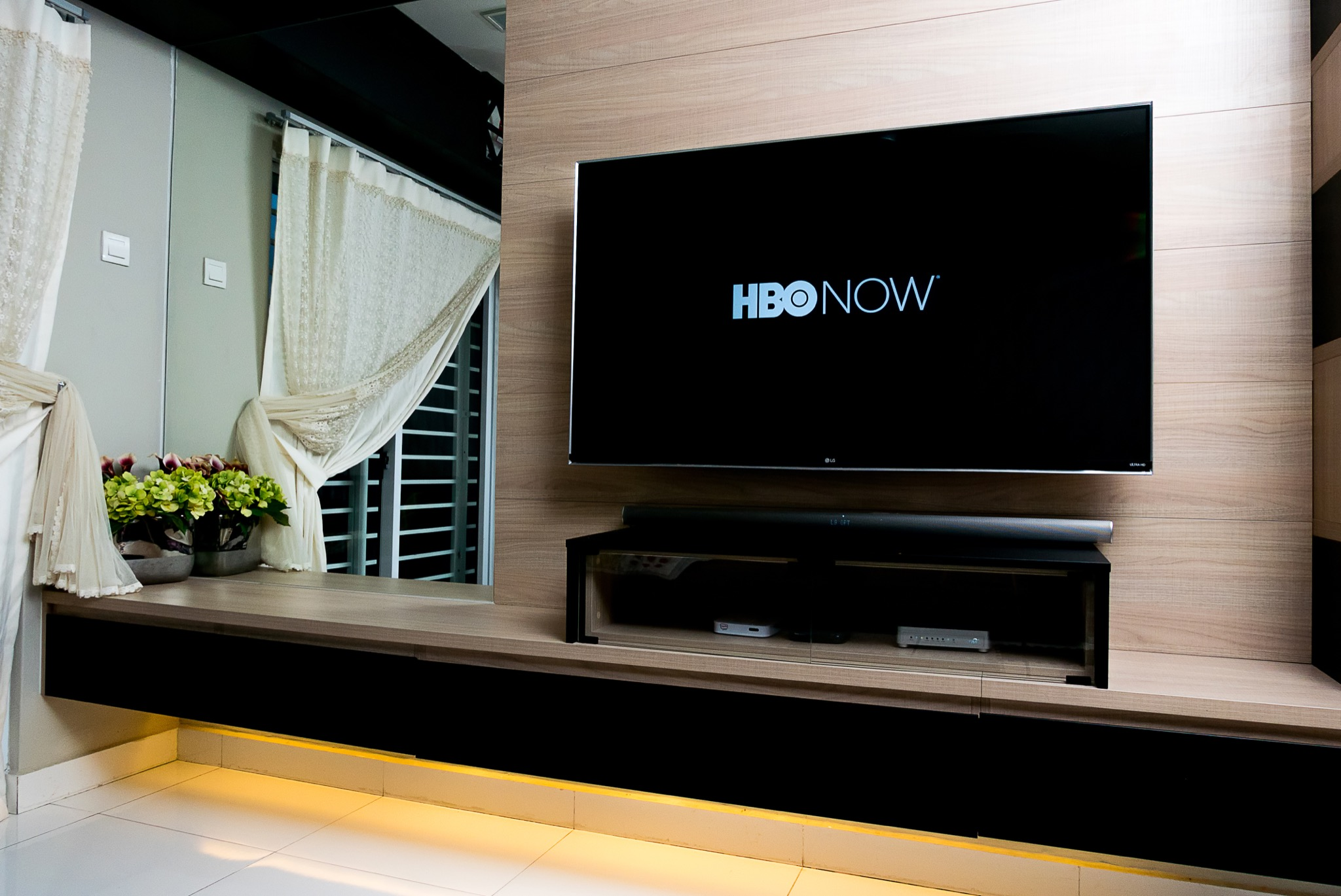 KUALA LUMPUR, MALAYSIA - SEPTEMBER 7TH, 2018 : Modern lifestyle with LG Android TV to stay connected & browsing media using favourite Apps. TV display HBONow app over dark background. - Image